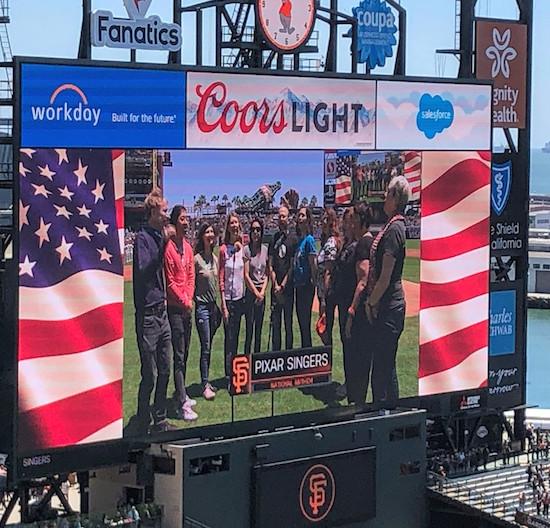 pixar singers sing the national anthem
