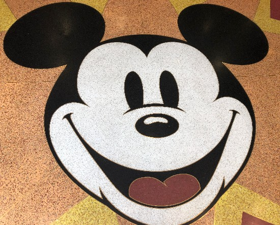 mickey face on the floor that looks like old cartoons
