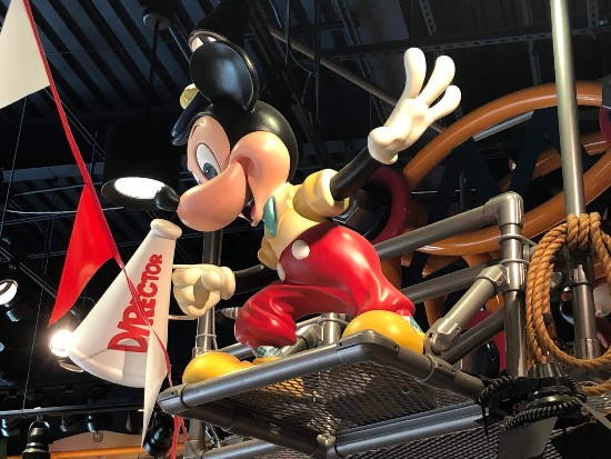 mickey as a director in pipe rail disney store